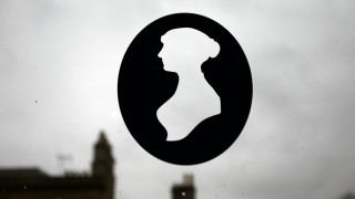 A silhouette of Jane Austen is seen in a window at the Jane Austen Centre in Bath