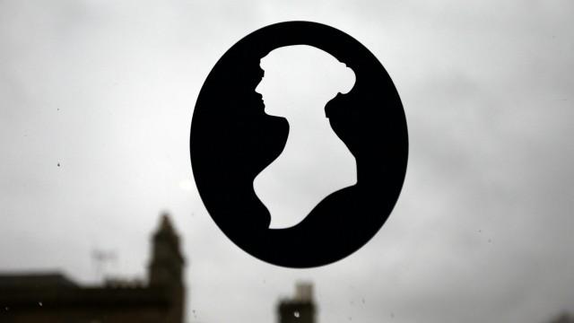 A silhouette of Jane Austen is seen in a window at the Jane Austen Centre in Bath