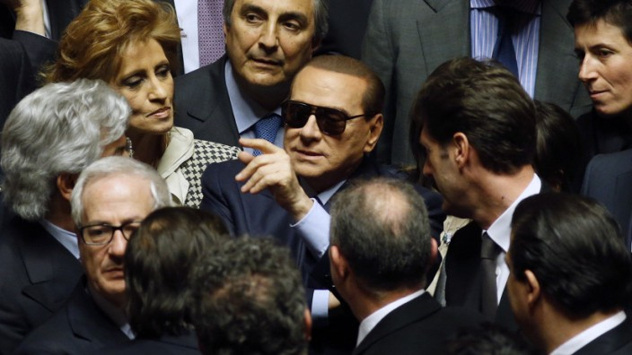 File photo of Italy's former Prime Minister Berlusconi surrounded as he arrives at the Senate in Rome
