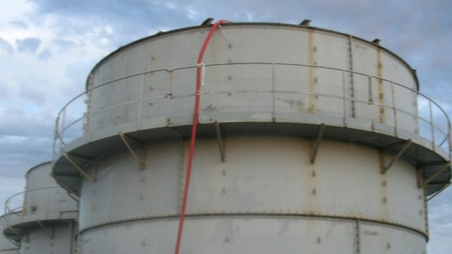 Handout photo shows a tank holding highly contaminated water, which is leaking, at TEPCO's Fukushima Daiichi nuclear power plant