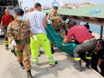 At least 93 migrants die as ship sinks off Italian coast