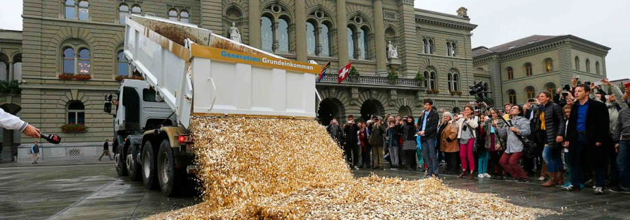 Truck dumps five cent coins in the centre of the Federal Square during event organised by Committee for initiative Grundeinkommen in Bern