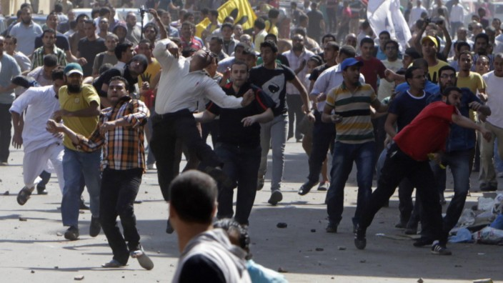 Supporters of deposed President Mursi and Muslim Brotherhood clash with anti-Mursi protesters during march in Shubra street in Cairo