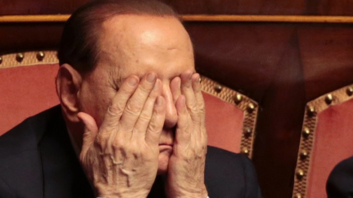 Italian center-right leader Berlusconi gestures during confidence vote at the Senate in Rome