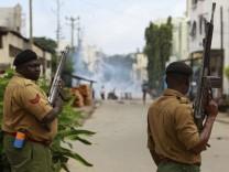 Kenya police attempt to suppress demonstrators reacting to the killing of an Islamic cleric at Kenya's coastal city of Mombasa