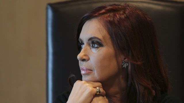 Argentina's President Fernandez de Kirchner attends a meeting with her Venezuelan counterpart Chavez to sign agreements in Brasilia