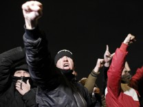 Men shout slogans after a protest in the Biryulyovo district of Moscow
