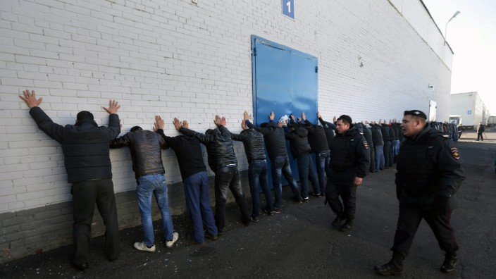 Russian police detain alleged illegal migrants