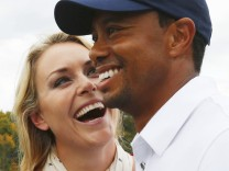 U.S team member Woods celebrates with girlfriend Vonn after Woods won his match and the U.S. won the Presidents Cup on the18th hole in the 2013 Presidents Cup golf tournament at Muirfield Village Golf Club in Dublin