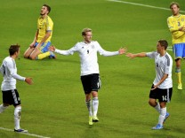 Germany's Schuerrle celebrates his goal against Sweden with teammates during their 2014 World Cup qualifying soccer match in Stockholm