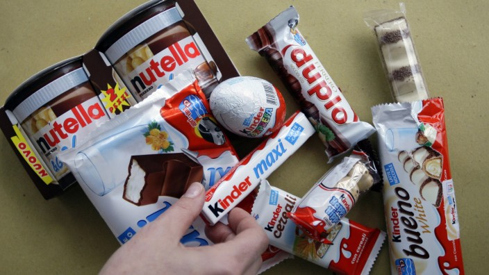 A woman takes a Kinder Ferrero chocolate in Milan