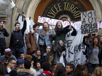 French high school students demonstrate in front of their Lycee Turgot in Paris