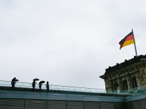 People take walk on roof of Reichtsag building in Berlin