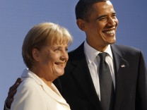 German Chancellor Merkel poses with U.S. President Obama at a reception for the G20 Summit in Pittsburgh