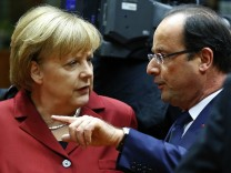 Germany's Chancellor Merkel talks with France's President Hollande arrive at a European Union leaders summit in Brussels