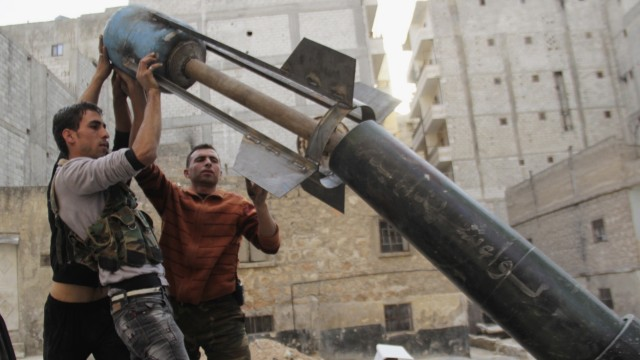 Free Syrian Army fighters prepare to fire home-made rocket towards forces loyal to President Al-Assad in Ashrafieh, Aleppo