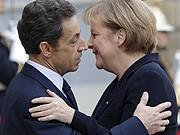 Merkel, Sarkozy, AFP