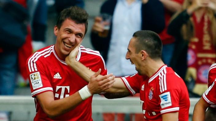 Mandzukic of FC Bayern Munich celebrates during their German first division Bundesliga soccer match against Hertha Berlin in Munich