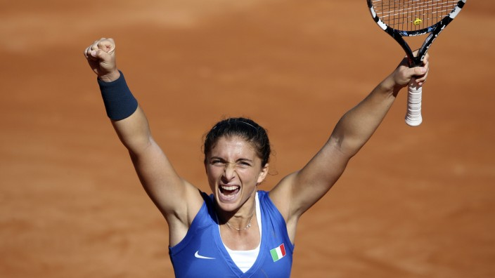 Italy's Errani celebrates after winning a match against Russia's Kleybanova during their Fed Cup World Group women's tennis final match in Cagliari