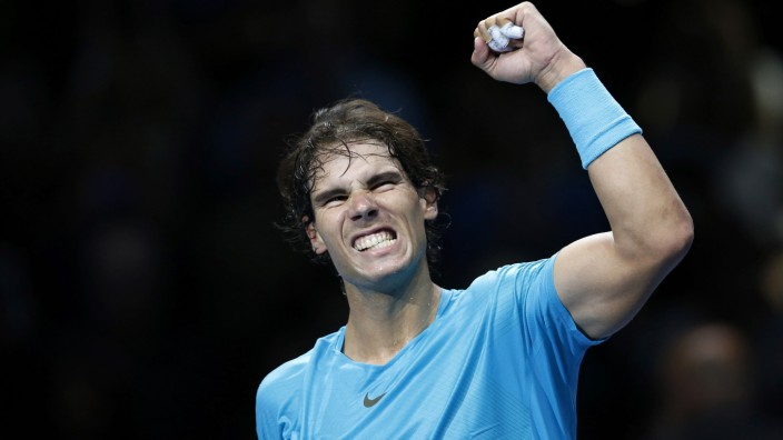 Nadal of Spain celebrates winning his men's singles tennis match against compatriot Ferrer at the ATP World Tour Finals at the O2 Arena in London