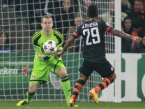 Shakhtar Donetsk's Alex Teixeira fights for the ball with Bayer Leverkusen's goalkeeper Bernd Leno during their Champions League soccer match at the Donbass Arena stadium in Donetsk