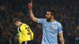 Manchester City's Negredo celebrates scoring his second goal against CSKA Moscow during their Champions League soccer match at the Etihad Stadium in Manchester
