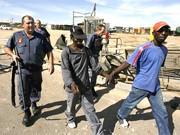 Verhaftung in Johannesburg, dpa