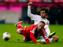 Augsburg's Moravek challenges Bayern Munich's Ribery  during their German first division Bundesliga soccer match in Munich