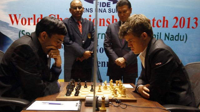 Norway's Carlsen plays against India's Anand during the FIDE World Chess Championship in Chennai