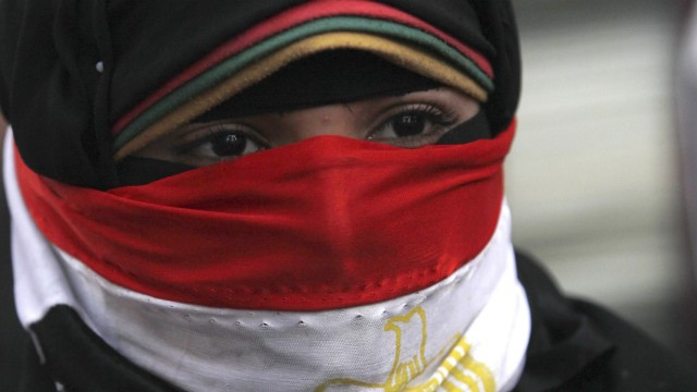 File picture shows a woman taking part in a protest rally against then Egyptian President Mursi and the Muslim Brotherhood in Cairo