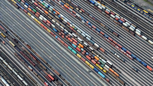 File photo of containers and cars being loaded on freight trains at the railroad shunting yard in Maschen near Hamburg