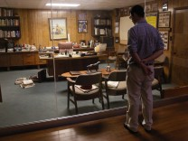 Nate Kettlewell, a Wal-Mart Stores Inc employee looks at company founder Sam Walton's office at the Walmart visitors center in Bentonville