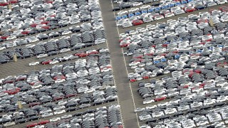 File photo of cars for export standing in a parking area at a shipping terminal in harbour of Bremerhaven