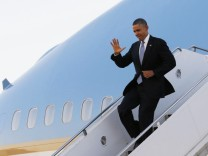 U.S. President Barack Obama waves upon arriving at Dallas Love Field in Texas