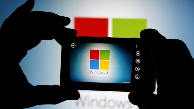 File photo illustration of man using the camera of a Nokia Lumia 820 smartphone