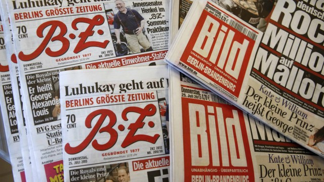 Copies of newspapers of German publisher Axel Springer are pictured in newspaper shop in Berlin