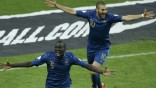France's Sakho and Benzema react after Ukraine's Guslev scored an own goal during their 2014 World Cup qualifying second leg playoff soccer match against Ukraine at the Stade de France in Saint-Denis near Paris