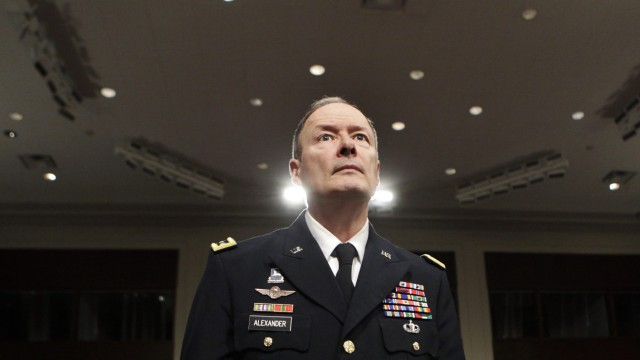 General Keith Alexander arrives at a Senate Appropriations Committee hearing in Washington