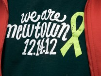 Wagner wears a t-shirt showing his support for Newtown as protesters gather at Walmart during an anti-gun protest in Danbury, Connecticut