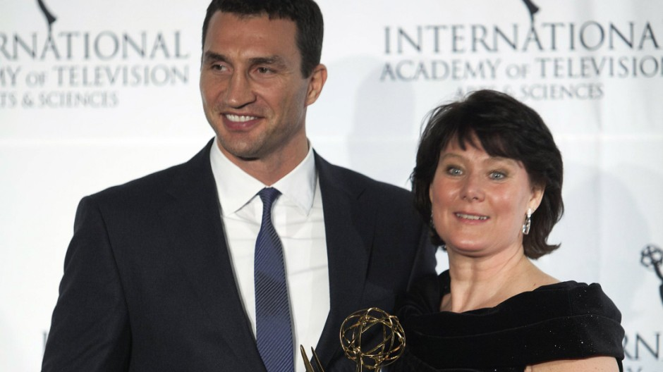 Boxer Klitschko of Ukraine and CEO of RTL TV Schaeferkordt of Germany pose for photographers with her Directorate Award backstage during the 41st International Emmy Awards in New York