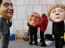 Environmental activists of 'Campact!', wear masks during protest outside coalition talks at CDU party headquarters in Berlin