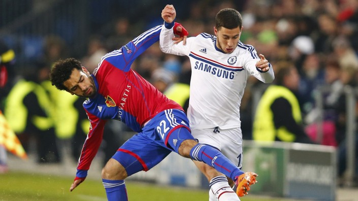 Basel's Mohamed Salah challenges Chelsea's Eden Hazard during their Champions League Group E soccer match at St. Jakob-Park in Basel