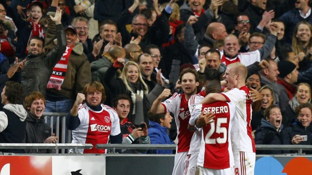 Ajax Amsterdam's Hoesen celebrates his goal with team mates during their Champions League group H soccer match against Barcelona at Amsterdam Arena