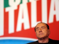 Former Prime Minister Silvio Berlusconi closes his eyes during a speech in downtown Rome