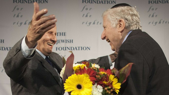 Holocaust survivor Leon Gersten (R) greets Czelaw Polziec at JFK airport in New York