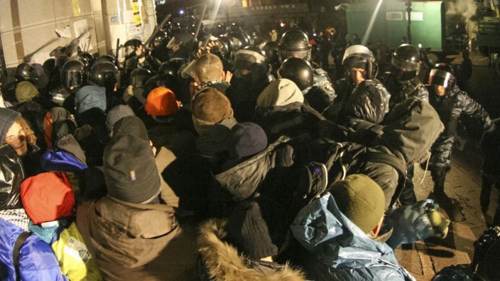 Protesters scuffle with the police during a demonstration in support of EU integration at Independence Square in Kiev