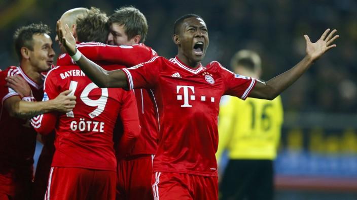 Bayern Munich's Alaba reacts after Goetze scored a goal against Borussia Dortmund during their German first division Bundesliga soccer match in Dortmund