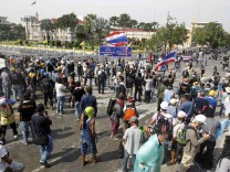 Anti-government protesters gather around the Government House during a rally in Bangkok