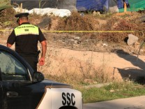 Authorities mark off a security fence surrounding a radioactive s