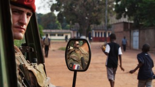 French soldiers stand guard during a patrol to check on the safety of French nationals in Bangui